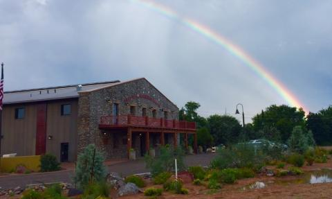 Camp Verde Community Library building with rainbow in the sky over it