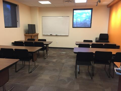 Founder's Room with classroom style seating and whiteboard